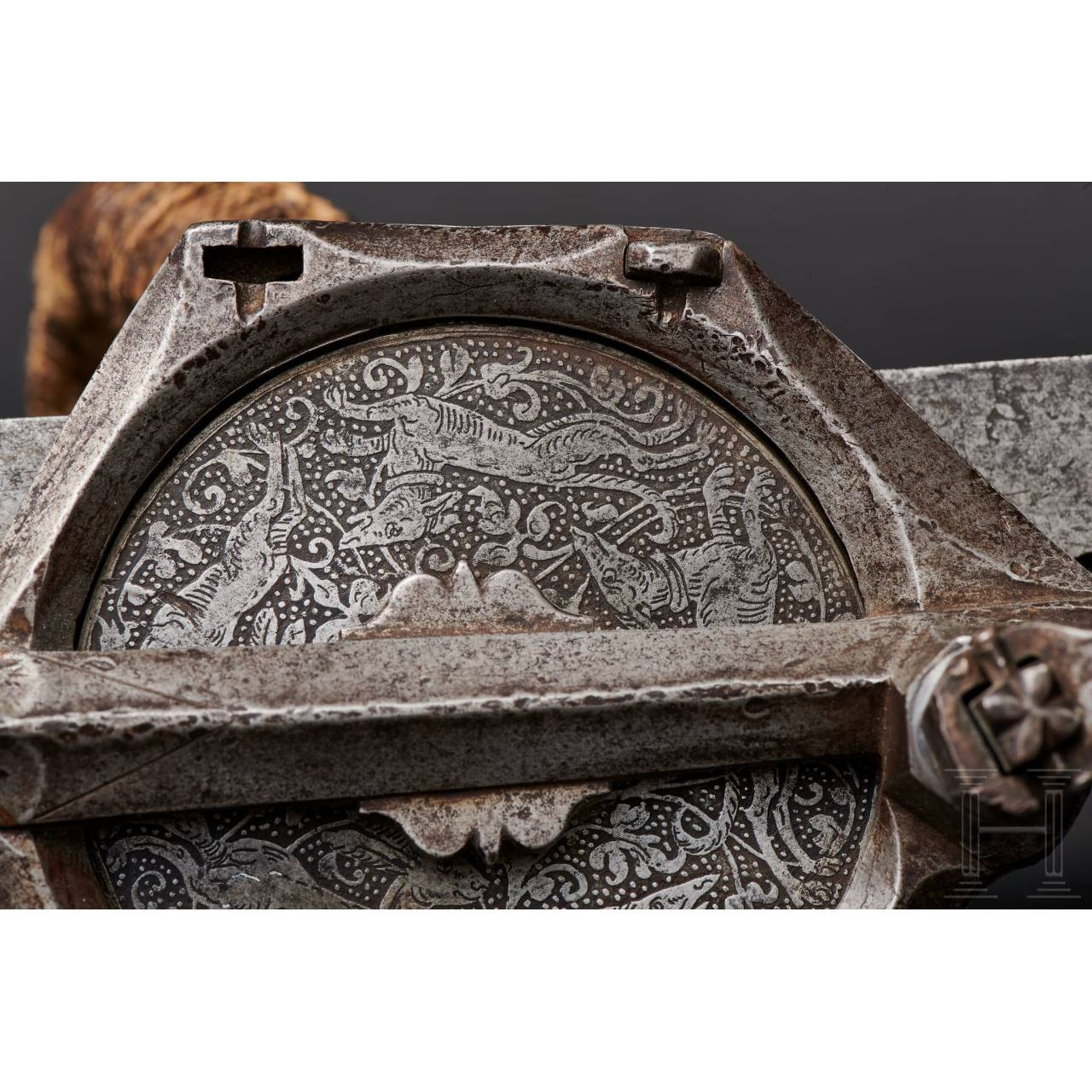 A Nuremberg crossbow winch with etched decoration, dated 1584