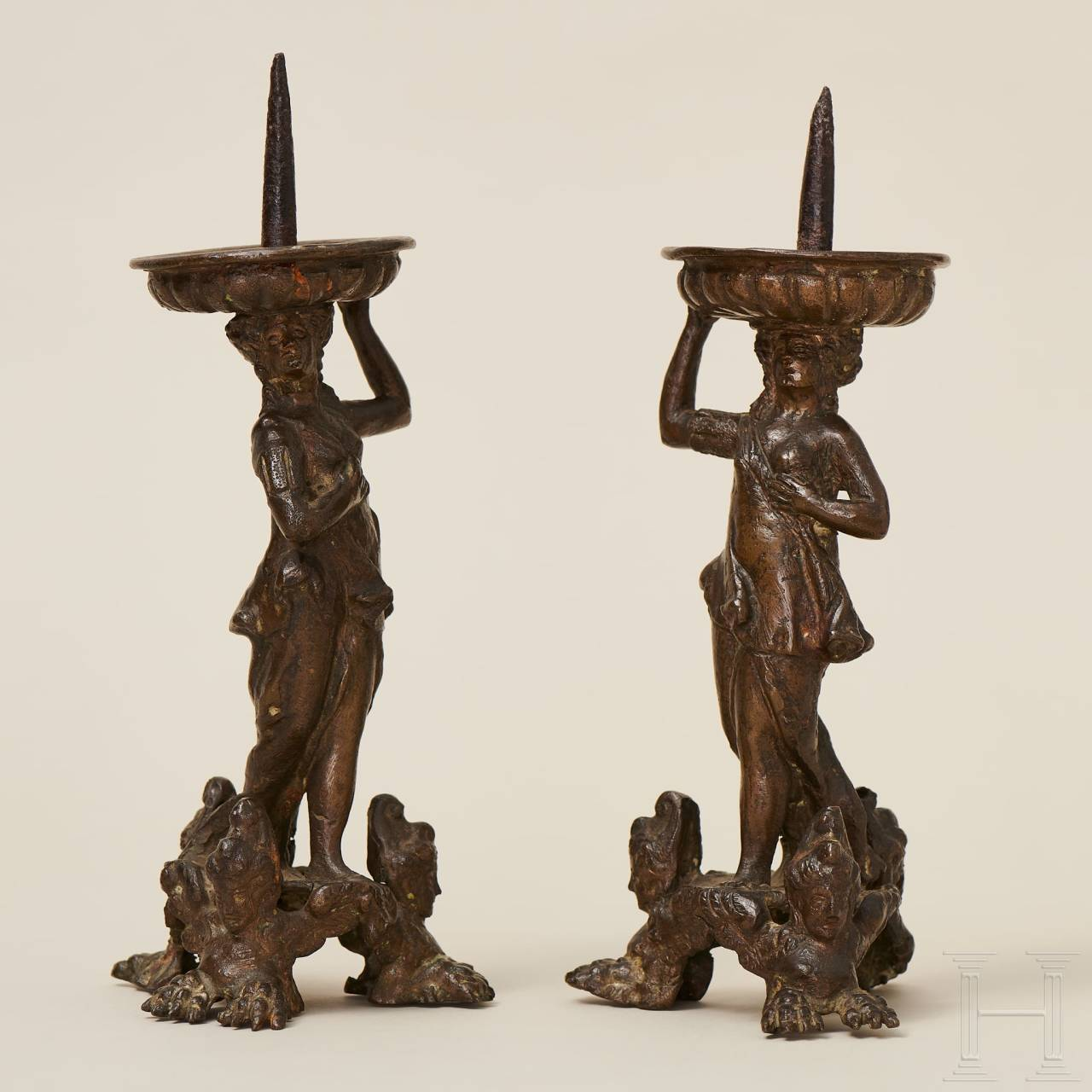 A pair of Italian figurative candle holders in bronze, 16th century