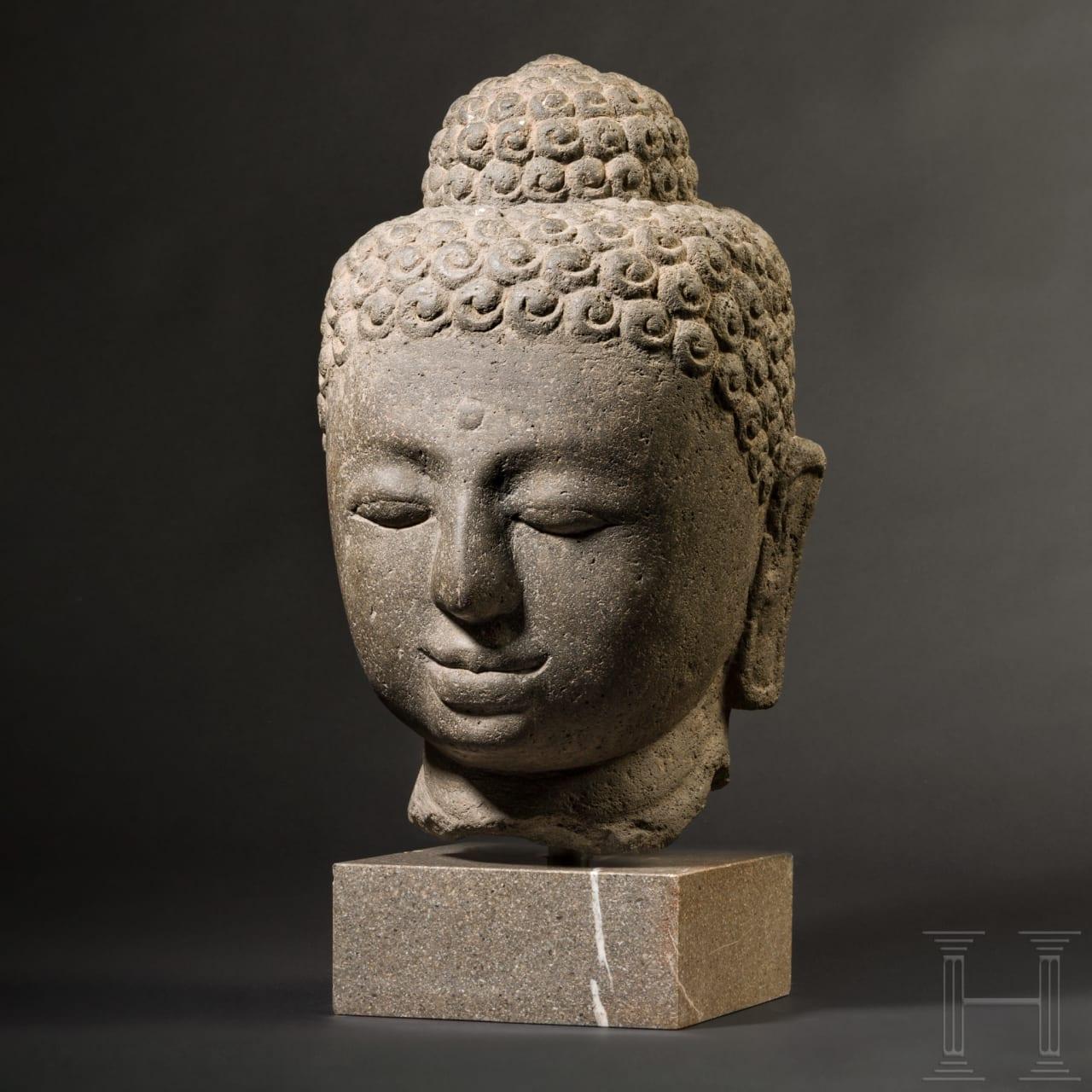 A large Buddha head carved in volcanic rock, Borobudur/Java, 9th century