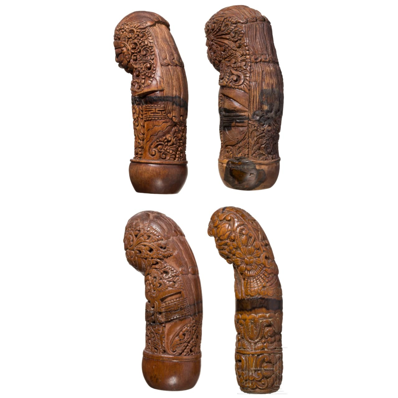 Four carved wooden kris hilts, Java and Madura, ca. 1900