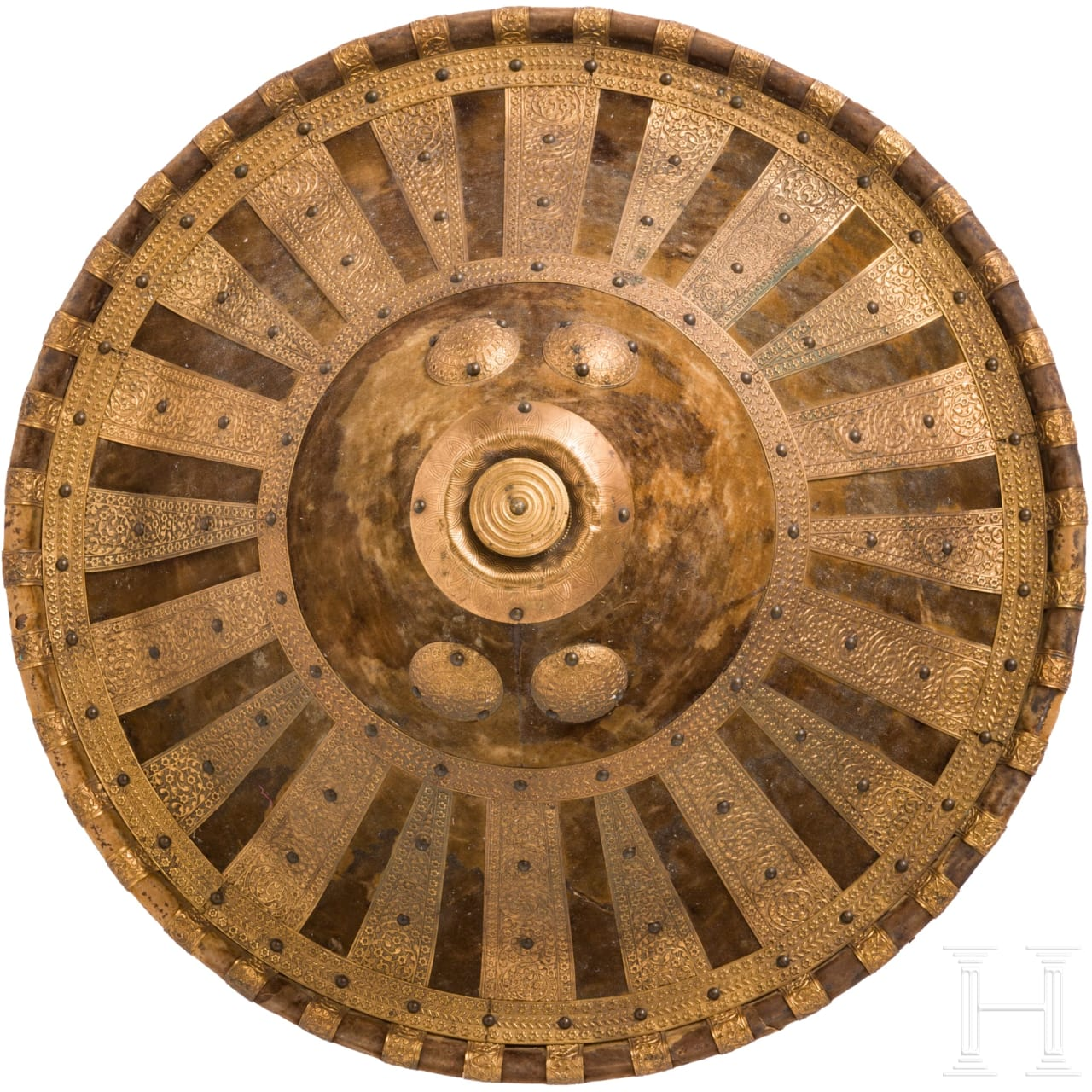 A shield of Amhara with gilded bronze fittings, Ethiopia, 1st half of the 20th century