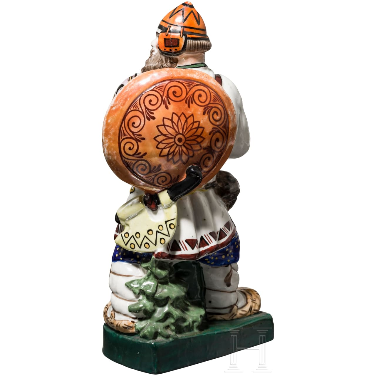 A hand-painted porcelain figurine of a bogatyr in neo-Russian style, circa 1915 – 1925