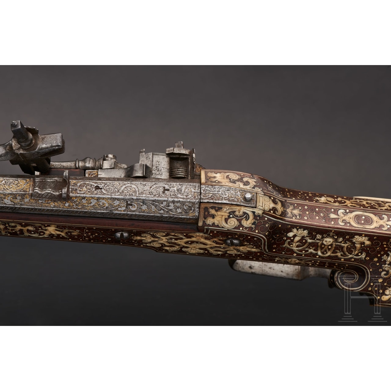 A significant South German wheellock rifle, veneered in bone, with etched lock and barrel, circa 1600