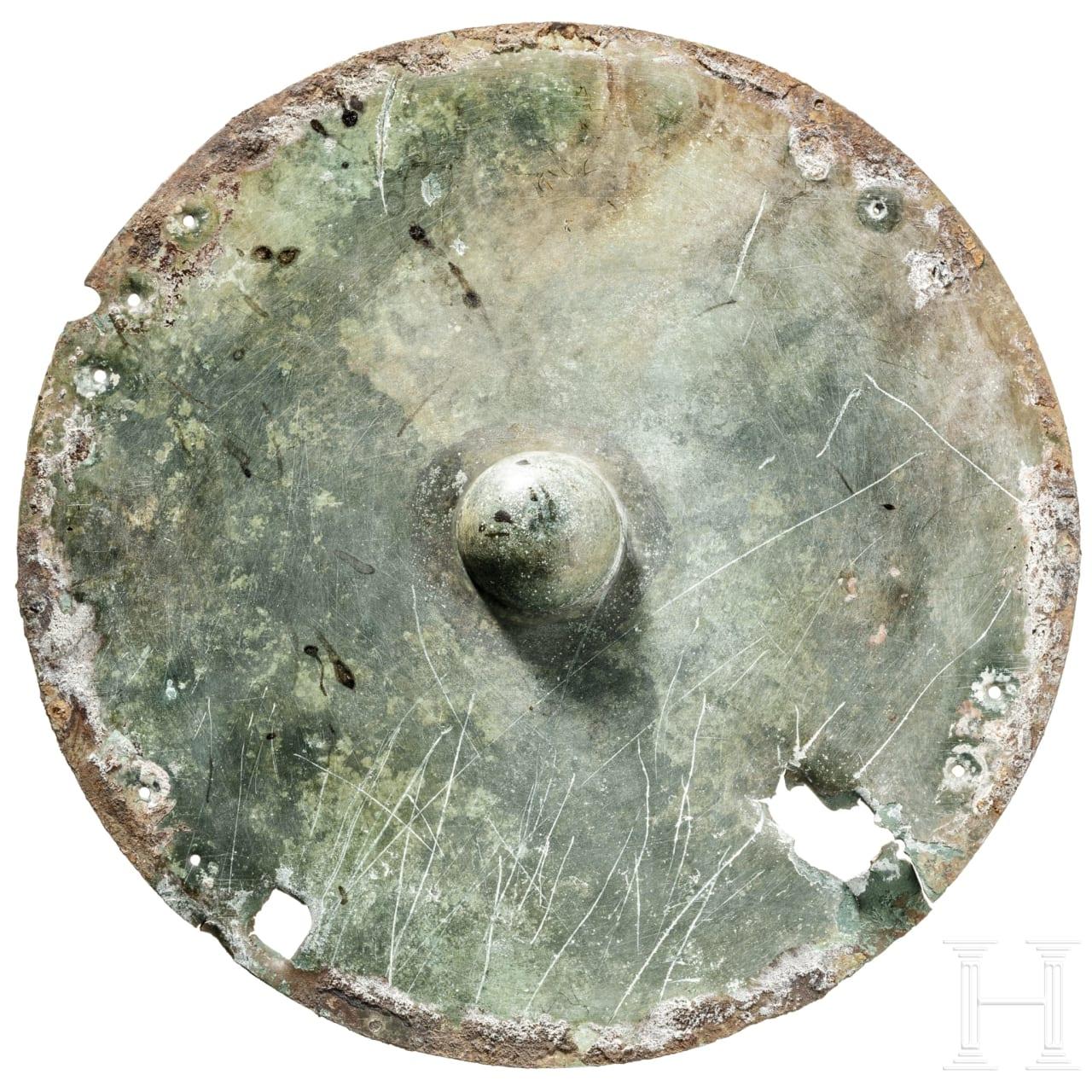 An Etruscan bronze shield boss, 7th century B.C.