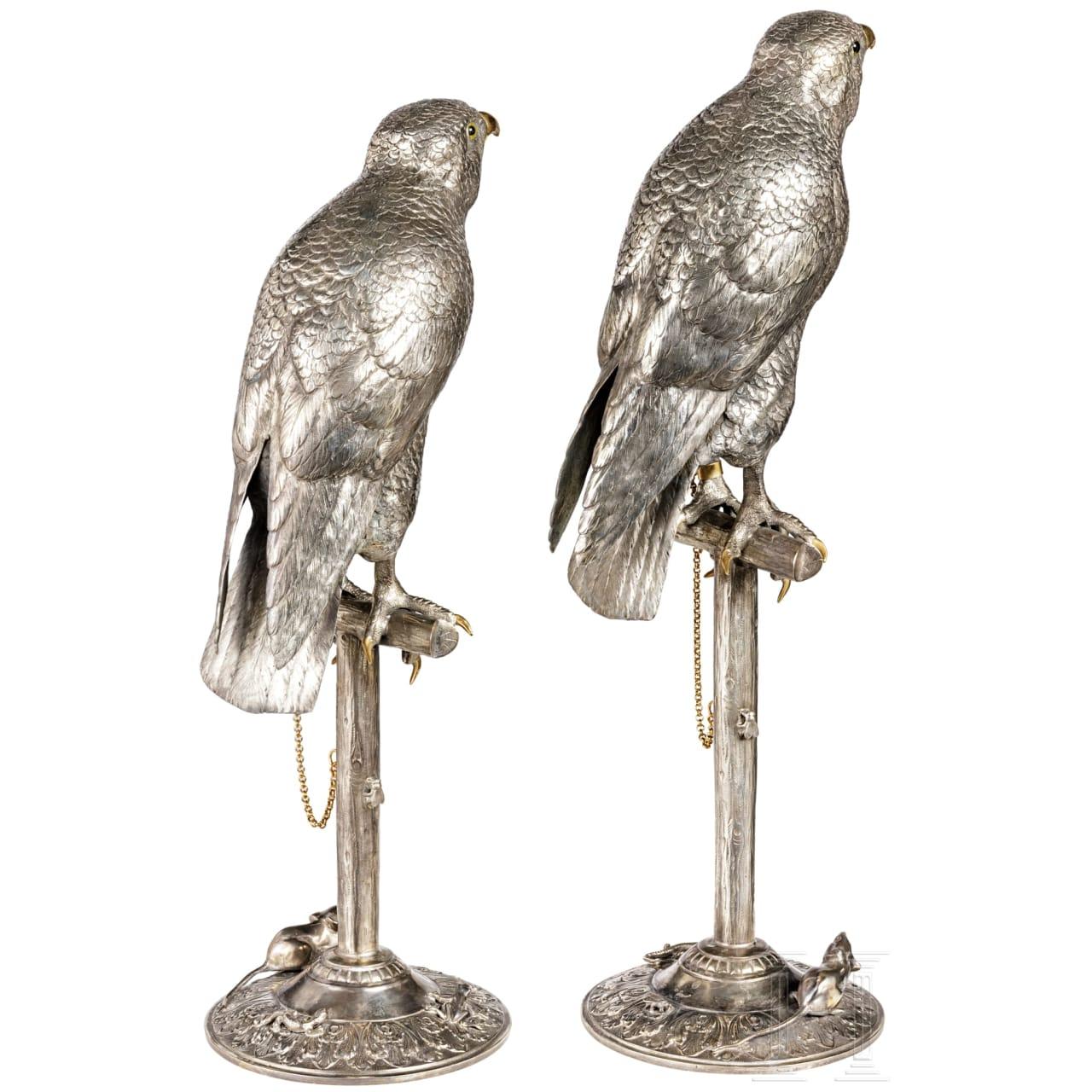 A pair of German silver falcons, circa 1900