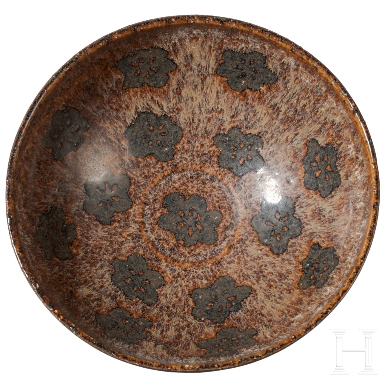 A rare Chinese Jizhou tea bowl with rosette decoration, southern Song dynasty, 12th - 13th century