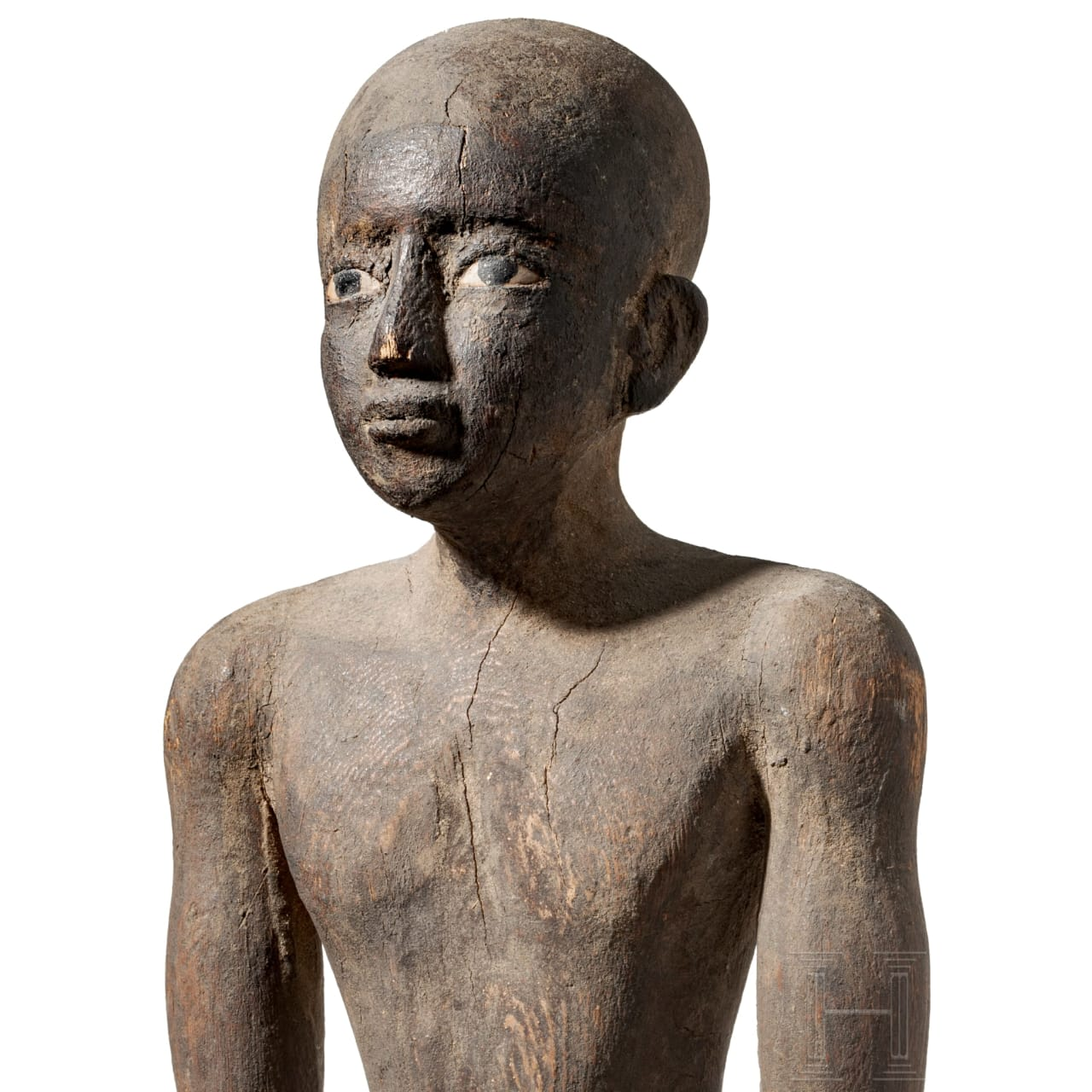 A masterful Egyptian wooden statuette of a high ranking official, Egypt, 16th century B.C.