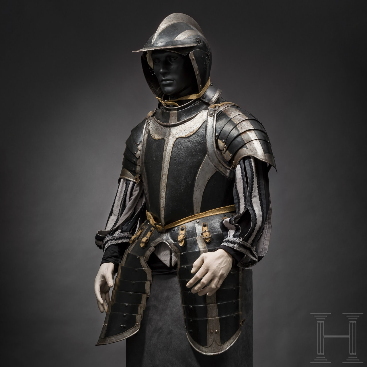 A German black and white armour for a man-at-arms, partly Augsburg, circa 1540-60