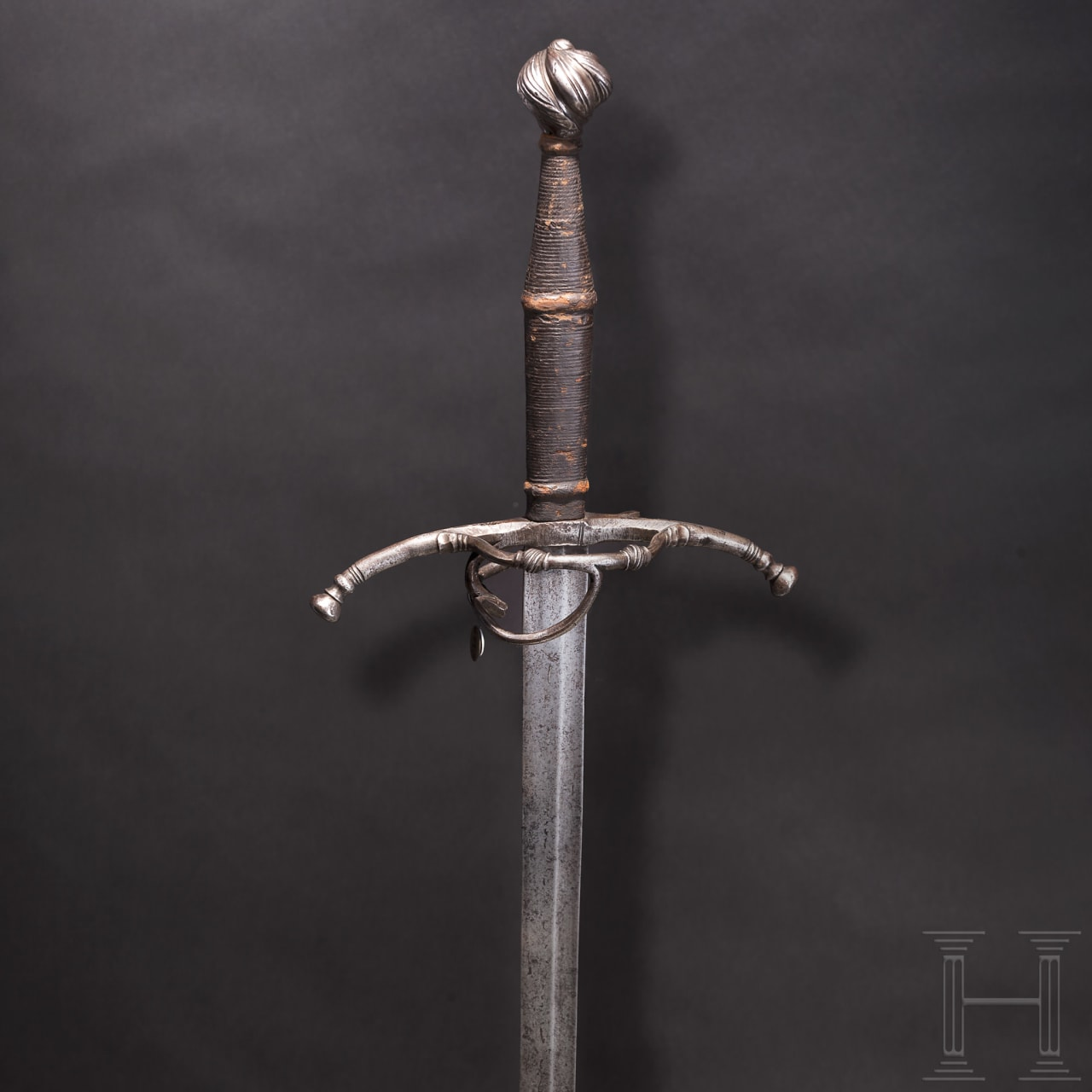 A South German Maximilian hand-and-a-half sword, circa 1520
