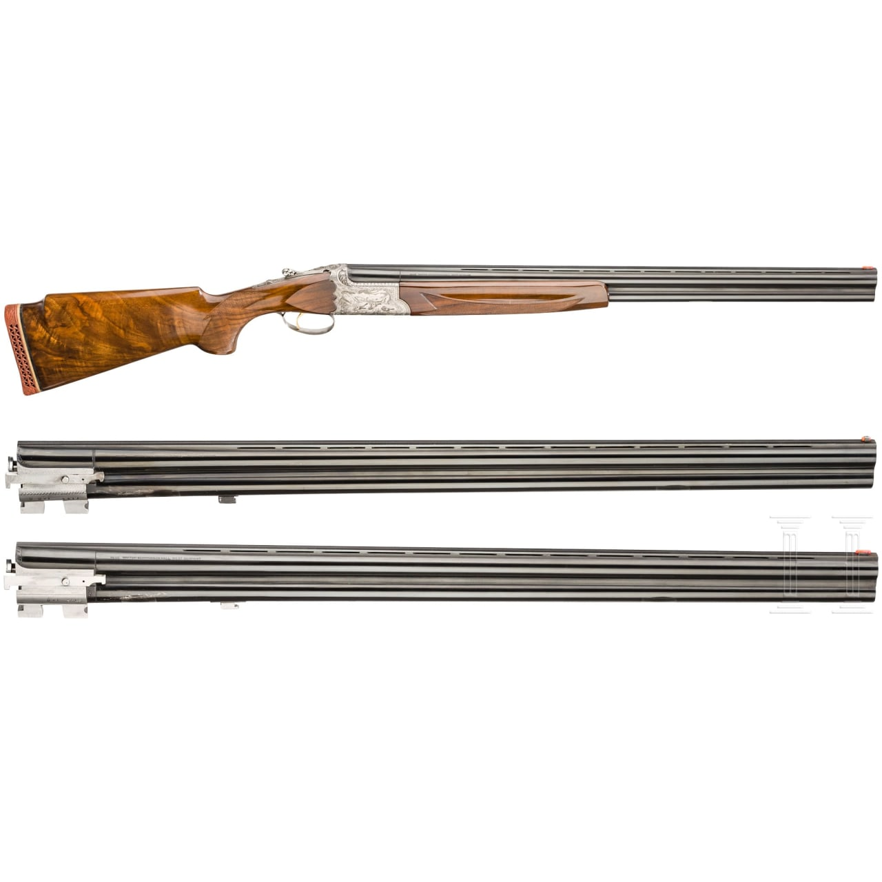 A cased over/under shotgun with two extra barrel sets, by I.A.B./Hege