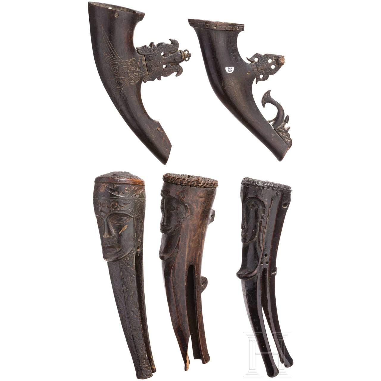 Two Indonesian wooden powder horns and three bullet horns, Batak, Sumatra, 18th century