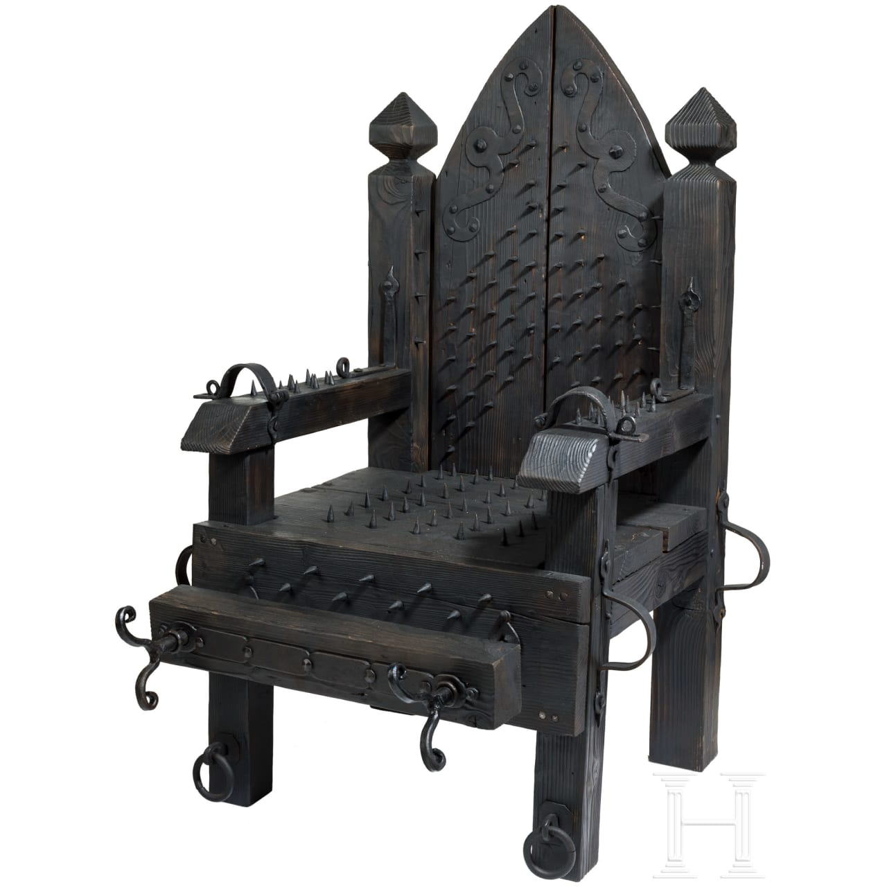 A torture chair, modern reproduction in the style of the 16th/17th century