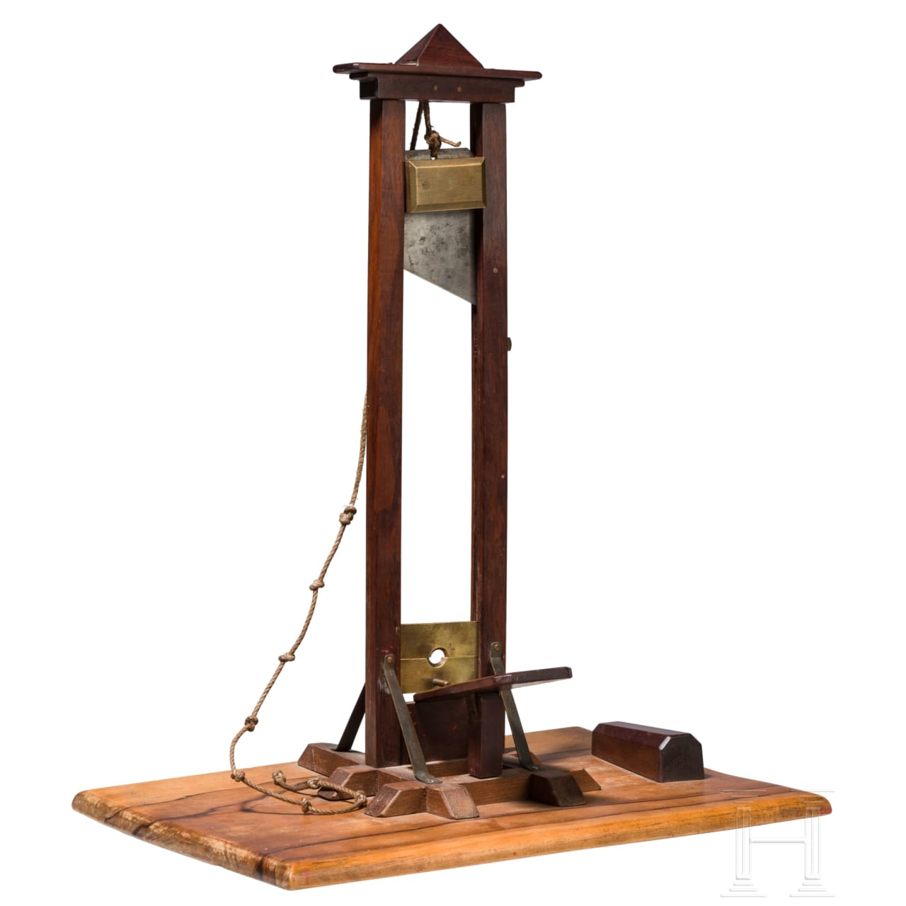 A French walnut, mahogany, iron and brass model of a guillotine, circa 1900