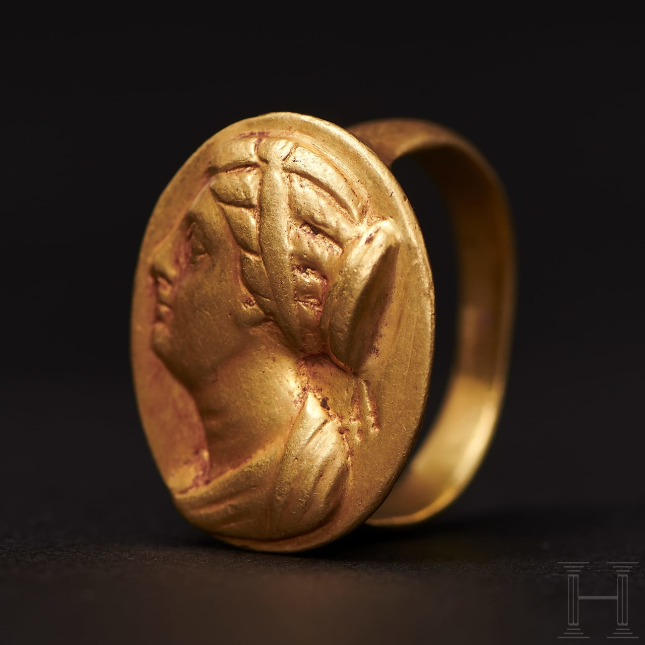 A Ptolemaic gold ring with the portrait of Berenice II, 3rd century B.C.