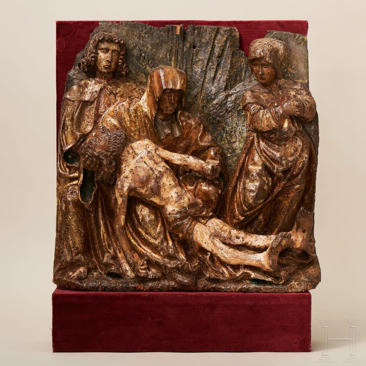 A Flemish carved relief panel showing the lamentation of Christ, late 15th century