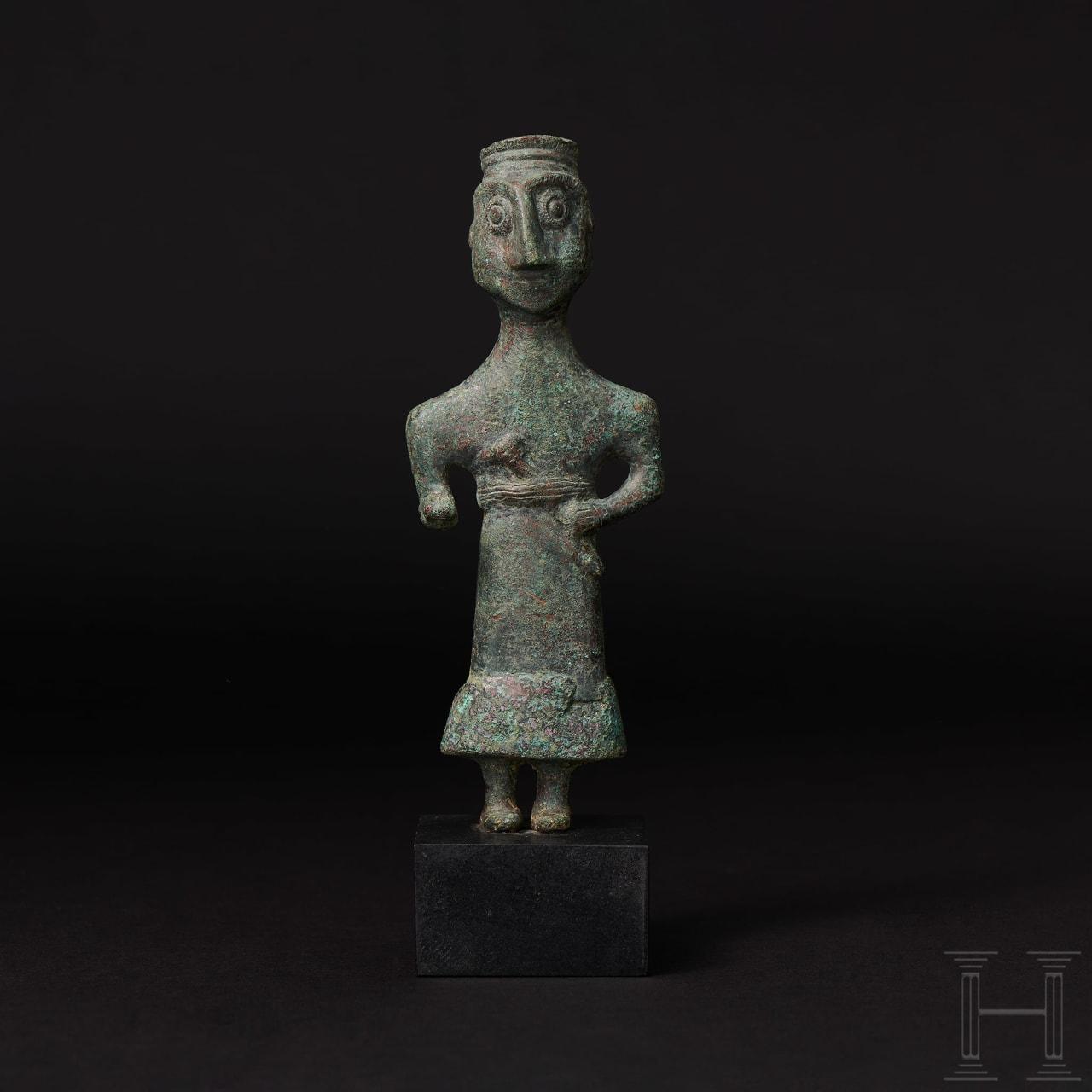 A superb Elamite bronze statuette of a dignitary, Near East, 3rd millennium B.C.