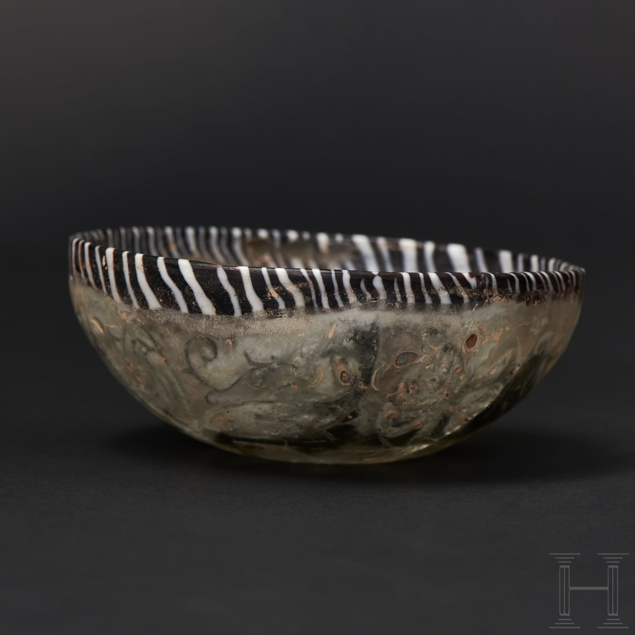 A late Hellenistic/early Roman glass bowl with floral décor in pigment coating between double walls, 1st century B.C. – 1st century A.D.
