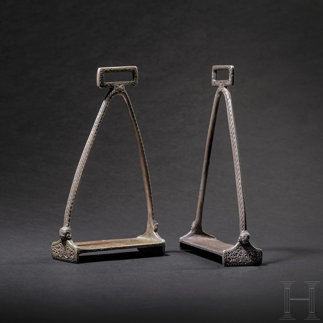 A pair of northern or eastern European silver Viking stirrups, circa 11th century