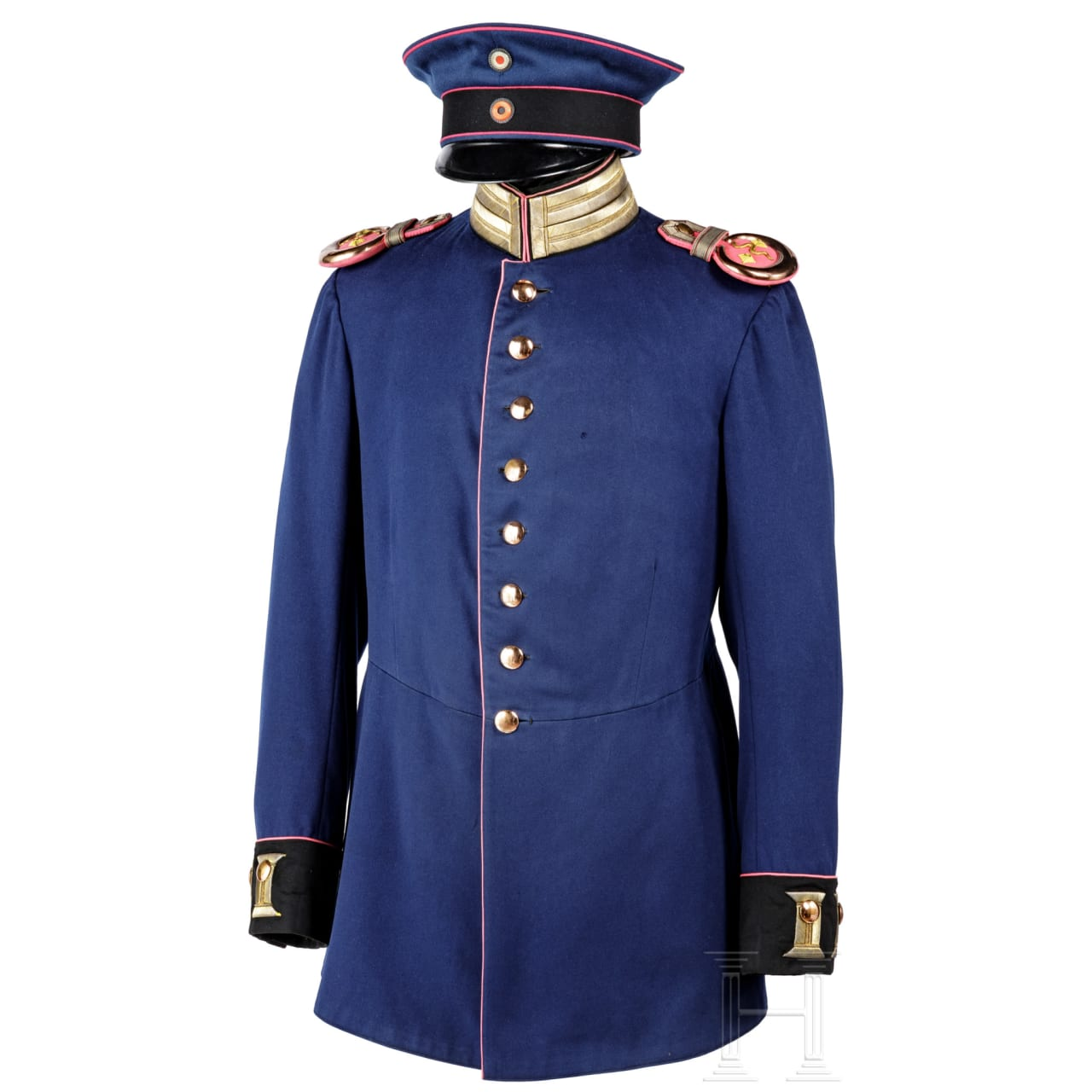 A cap and a parade tunic for an staff veterinarian