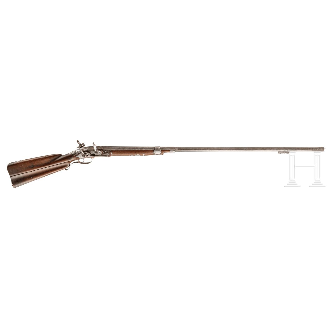 A Spanish silver-mounted Miquelet flintlock shotgun, 18th century