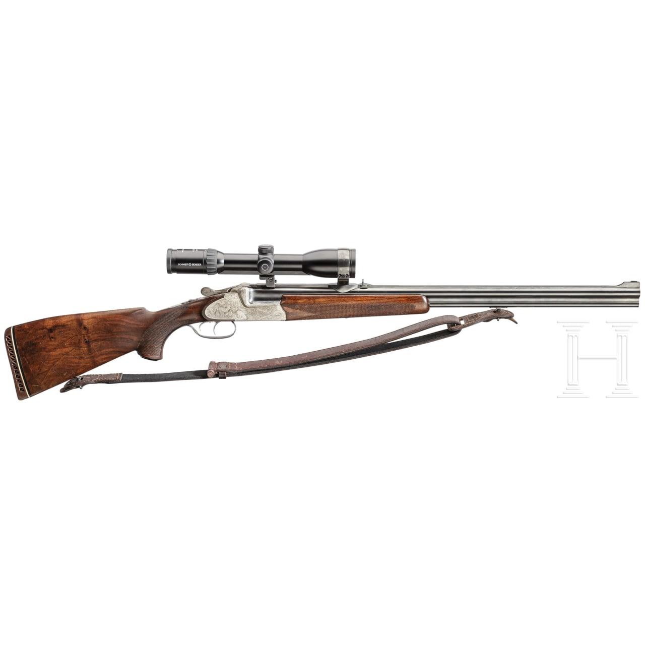 An over-and-under Scheiring-Düsel combination rifle with insert barrel and Schmidt & Bender scope