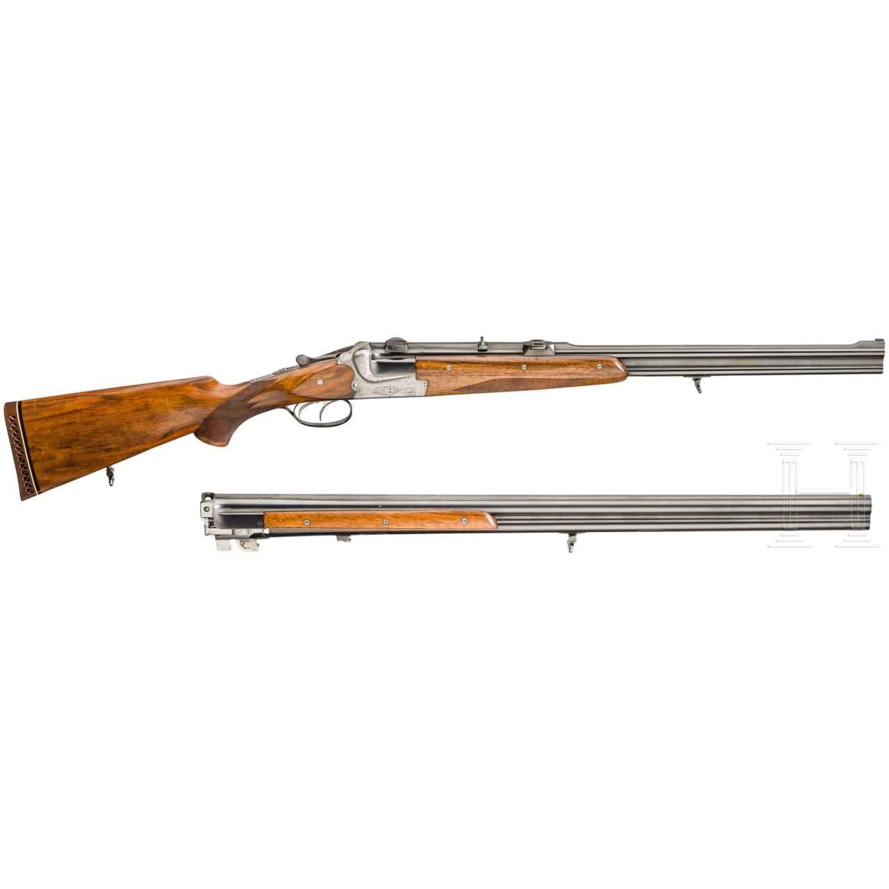 A cased double-barrelled over-and-under rifle by Hambrusch with three extra barrels