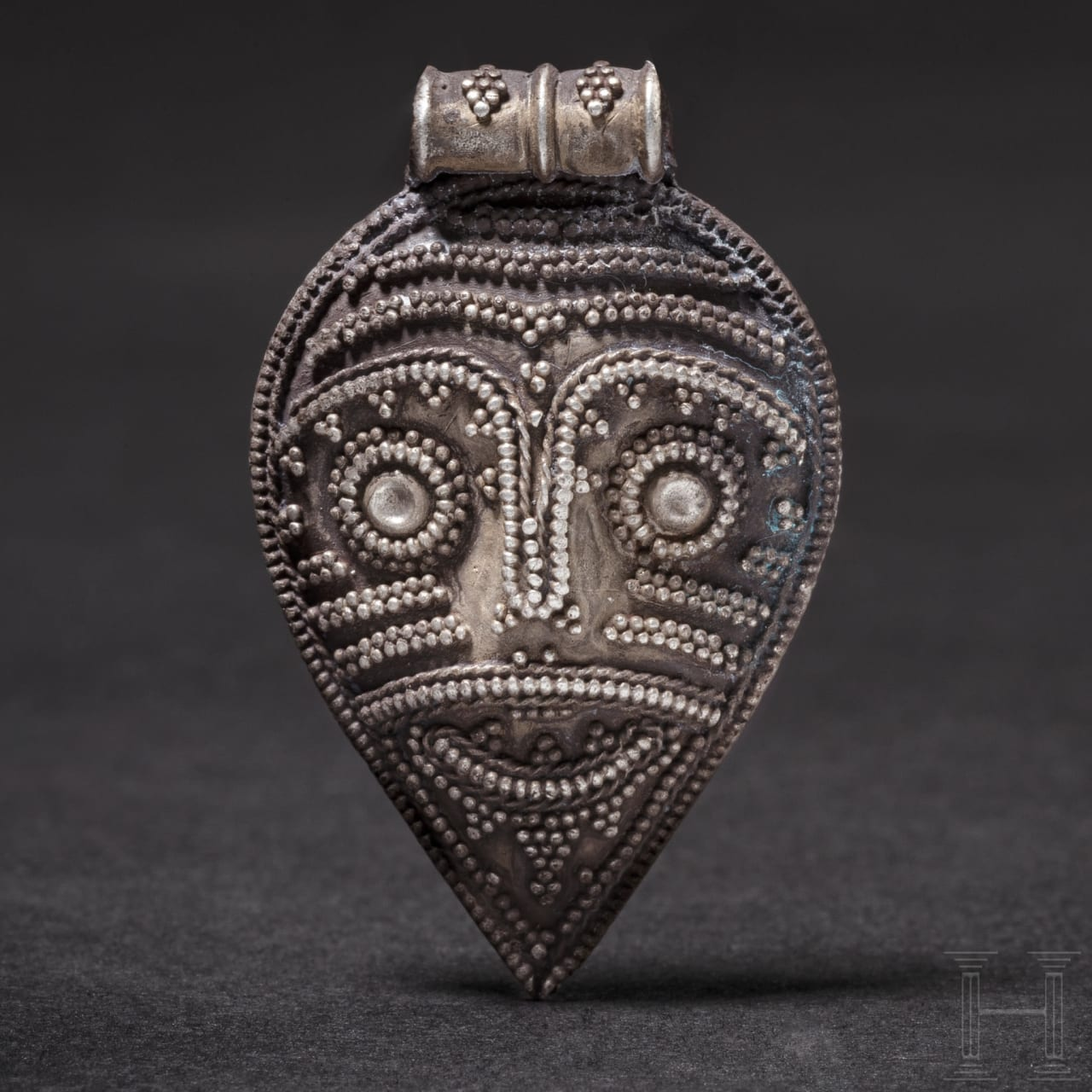 A Viking silver pendant with warrior head, 10th – 11th century