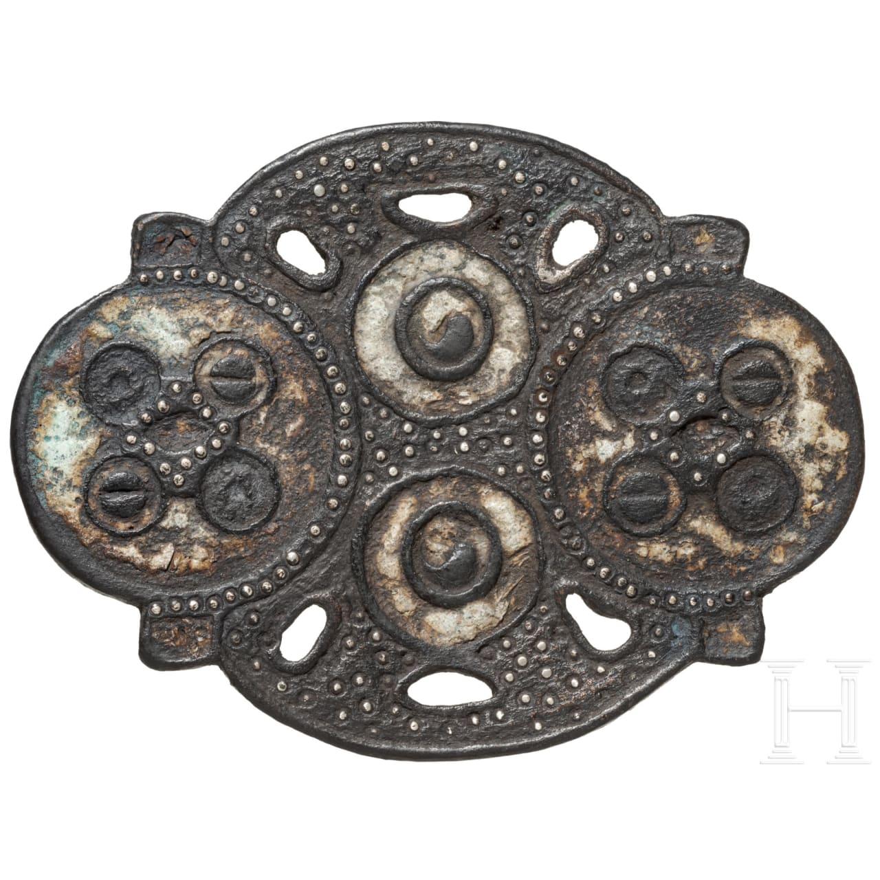 An enamelled Celtic bridle mount, 1st century B.C. - 1st century A.D.