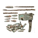 A Chinese crossbow lock and a collection of 29 arrow heads, Han dynasty, 206 B.C. – 220 A.D.