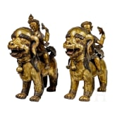 A pair of Sino-Tibetan foo lions with heavenly riders, 18th century