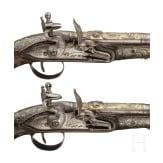 A pair of Ottoman silver-mounted deluxe flintlock pistols, circa 1820