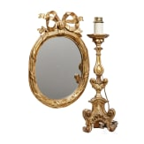 A fine German carved and original Louis XVI mirror with Baroque altar candle stick, 18th century