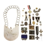 A militaria collection with orders, belt locks, ring collar