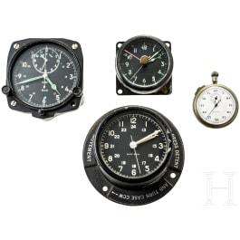 Two British Royal Air Force (RAF) on-board clocks + two clocks
