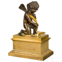 A neoclassical French fire gilded ink stand with a Cupid, Paris, circa 1830
