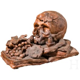 A large sculpted Italian terracotta still life as a memento mori with book and fruits, 19th century