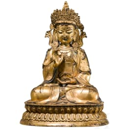 A large Sino-Tibetan fire-gilt bronze figure of Buddha Shakyamuni, 19th century