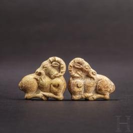 A pair of Achaemenid ibex appliqués in bone, 5th - 4th century B.C.