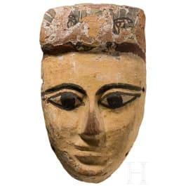 An Egyptian wooden mummy mask, Late Period, 664 - 31 B.C.