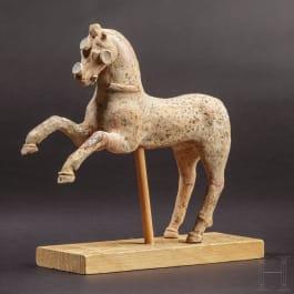 An impressive Greek-Hellenistic horse terracotta, 2nd - 1st century B.C.