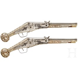 A pair of long wheellock pistols by Peter Danner, Nuremberg, dated 1587, with bone-inlaid stocks of later date