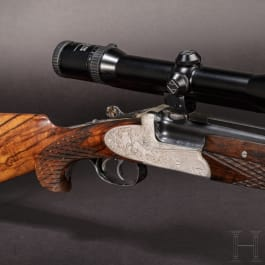 A Ferlach over-and-under rifle with Zeiss scope