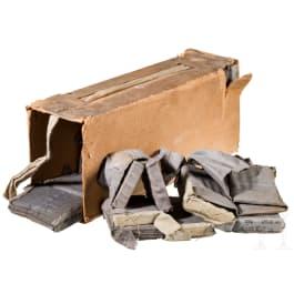 An original pack of four cartidge belts cal. 8 x 57IS