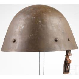 A Czech steel helmet, dated 1938