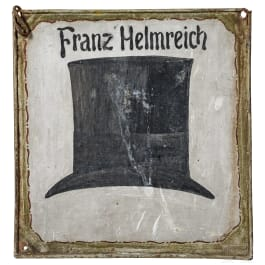 A German hatter's shop sign, dated 1877