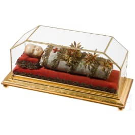 A South German swaddled baby with wax head in showcase, 19th century