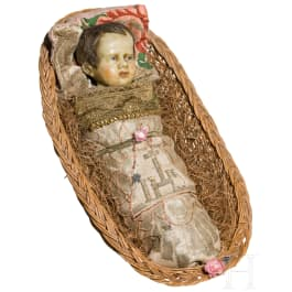 A South German swaddled baby in a basket, 19th century