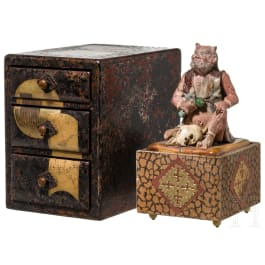 A small Japanese box with drawers and a figurine of an oni, Meiji period