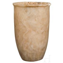 A tall, slender Egyptian alabaster cup, 2nd millennium B.C.