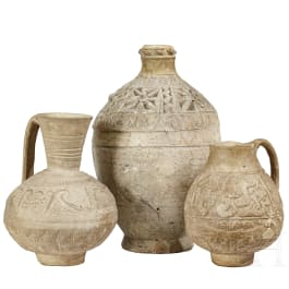 Three Persian-Islamic clay vessels with relief decoration, 10th - 15th century